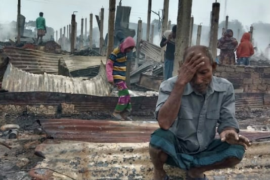 A Rohingya man reacts after a fire burned houses of the Nayapara refugee camp in Cox's Bazar, Bangladesh, January 14. (Image: Reuters)