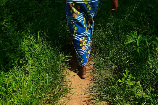 (For representation: File photo of a woman walks barefoot through a field in Chiyobola village, close to the town of Chikuni in the south of Zambia.   REUTERS/Darrin Zammit Lupi