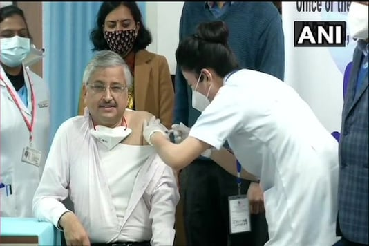 AIIMS Director Dr Randeep Guleria receives the Covid vaccine on Saturday, January 16.