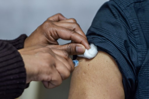 A medic administers a shot of Covishield vaccine to a frontline worker (PTI Photo)