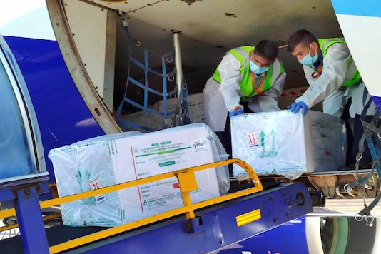 Health workers unload the first consignment of COVID-19 vaccine, in Indore. (PTI Photo)