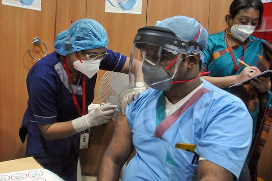 A medic administers the Covid-19 vaccine to a frontline worker. The healthcare budget includes Rs 35,000 crore for the vaccination programme.