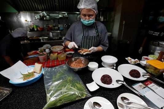 A chef prepares a pork sandwich with a marijuana leaf at Abhaibhubejhr hospital canteen.  REUTERS/Jorge Silva