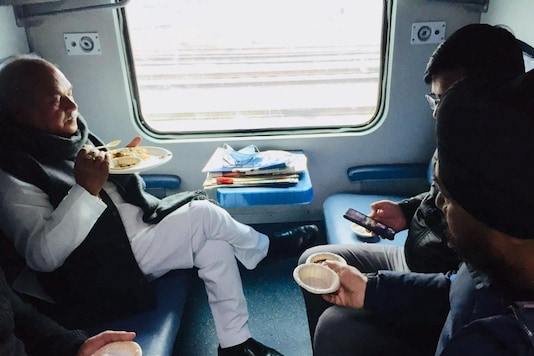 Agriculture minister Narendra Singh Tomar eats langar with the Sikh community on a train on Sunday.