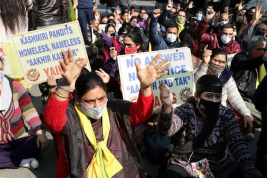 Members of the Youth All India Kashmiri Samaj shout slogans during a protest rally in front of the UNO office to observe the 19th January as Holocaust Day, in Jammu, on Tuesday, January 19, 2021. (Image: PTI)