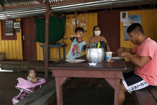 An indigenous family eats lunch at their home, amid the spread of the coronavirus  on the banks of the Negro river at the village Tres Unidos, Amazon state. (Image for representational purpose only/REUTERS)