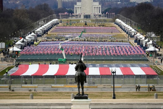 The National Mall is filled with a display of U.S. flags during  a dress rehearsal for U.S. President-elect Joe Biden's Presidential Inauguration at the U.S. Capitol, in Washington, U.S., January 18, 2021. Patrick Semansky/Pool via REUTERS - RC2IAL9655RZ