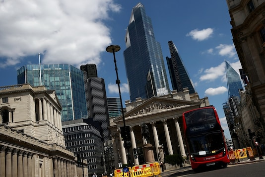 FILE PHOTO: A bus drives on an almost empty street, following the outbreak of the coronavirus disease (COVID-19), in the financial district of London.  REUTERS/Hannah McKay/File Photo