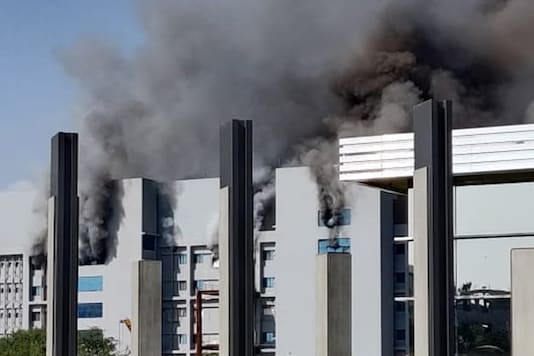 Smoke billows out after a massive fire broke out at the Serum Institute of India, in Pune, Thursday. (Image: PTI)