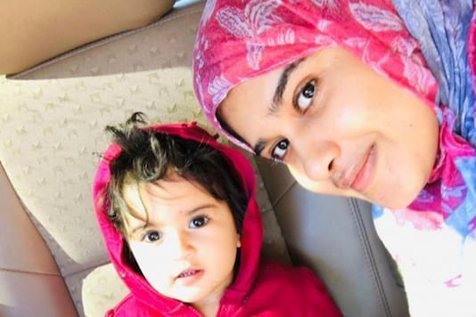 Lameaa Albarmaki poses with her daughter Dalal, 2, in this undated handout picture taken in an unknown location. Lameaa Albarmaki/Handout via REUTERS