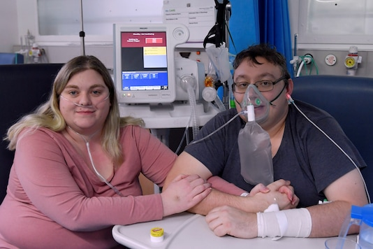 Lizzie Kerr, 31, and Simon O'Brien, 36, embrace in a COVID-19 ward, days after they married in an ICU (Intensive Care Unit) when both had become critically ill with the coronavirus disease (COVID-19), and were uncertain of their chances of surviving, in Milton Keynes University Hospital, Milton Keynes, Britain, January 20, 2021. REUTERS/Toby Melville