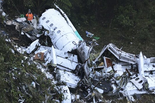 Rescue workers recover a body from the wreckage site of the LaMia chartered airplane crash, in La Union, a mountainous area near Medellin, Colombia.(AP File Photo