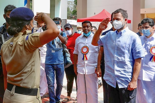 Congress leader Rahul Gandhi interacts with a student during the inauguration of the classroom building and school gate at Government Girls Higher Secondary School, at Wandoor in Malappuram District. (PTI Photo)