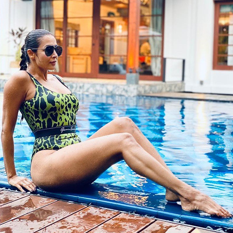 Summer may still be several weeks away but trust Malaika Arora to heat things up. Her svelte figure in sexy swimwear scorches the internet time and again. Scroll ahead to take a look at some of her hottest water looks. (Image: Instagram)