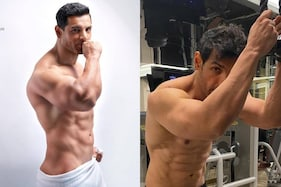 John Abraham's Ripped Body And Insane Workouts Will Motivate You To Hit The Gym