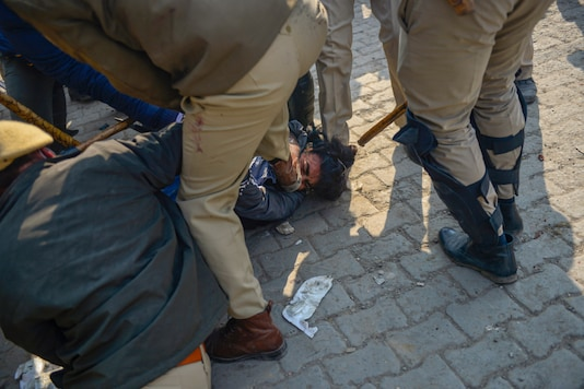 New Delhi: Police pin down a farmer, who allegedly attacked Police SHO (Alipur) Pradeep Paliwal, during clashes between people claiming to be local villagers and farmers at the Singhu Border in New Delhi, Friday, Jan. 29, 2021. (PTI Photo)
