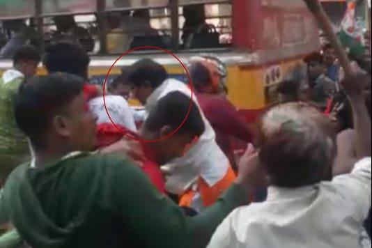 One of the BJP workers is attacked by the mob. (Videograb)