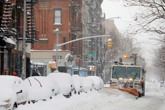 A snow plow clears a street during a snow storm, amid the coronavirus disease outbreak, in the Lower East Side neighborhood of Manhattan, in New York, U.S. (Reuters)