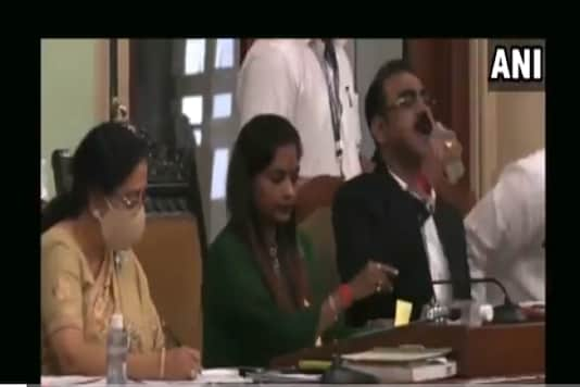 A senior official of the BMC erroneously drank sanitiser instead of water while presenting the civic body's education budget in Mumbai on Wednesday. (Image: ANI)