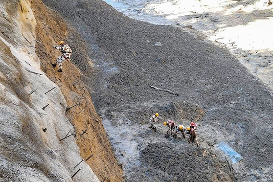 ITBP personnel dig to open Tapovan Tunnel which is completely blocked, after a glacier broke off in Joshimath in Uttarakhand's Chamoli district causing a massive flood in the Dhauli Ganga river, Sunday. (PTI)