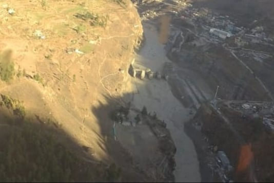 Broken dam and rubble along the Dhauliganga river valley close to the Tapovan dam.