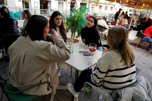 French women enjoy a meal on a terrace for their holiday week during the COVID-19 pandemic in Madrid, Spain.   (Credit: REUTERS/Juan Medina)