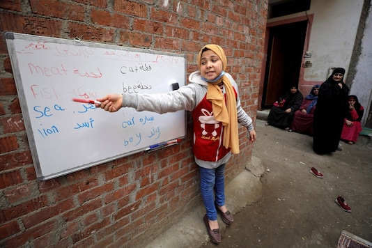Khouly started using just a notebook before being given a blackboard and some chalk. Now she has a whiteboard and marker pens donated by a local company. REUTERS/Mohamed Abd El Ghany