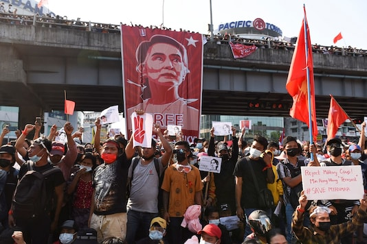 People rally against the military coup and to demand the release of elected leader Aung San Suu Kyi, in Yangon, Myanmar, on February 9, 2021. (REUTERS)