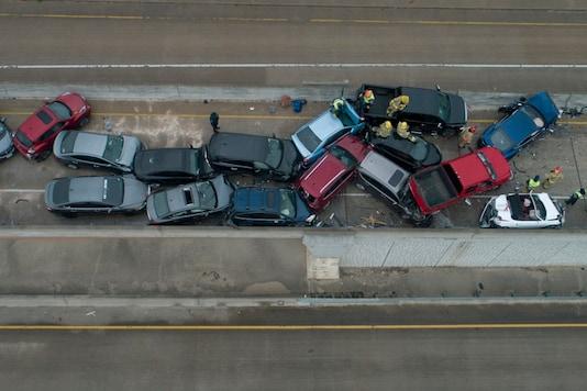 Emergency responders work at a multi-car pileup on Sate Highway 45 near Briarwick Drive on Thursday, Feb. 11, 2021, in Austin, Texas. (AP)
