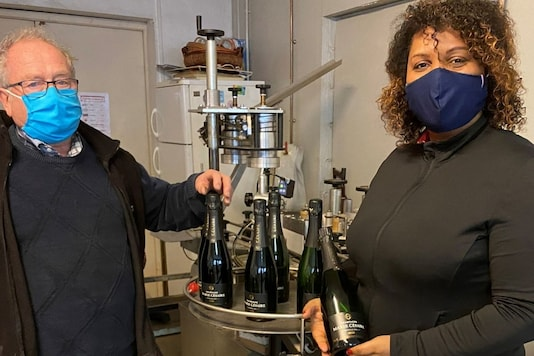 Marie-Ines Romelle, founder and owner of the Marie Cesaire Champagne, poses with her business partner vine-grower Anselme Lefevre in her wine cellar in Reims, France (Pic Credit: Reuters)