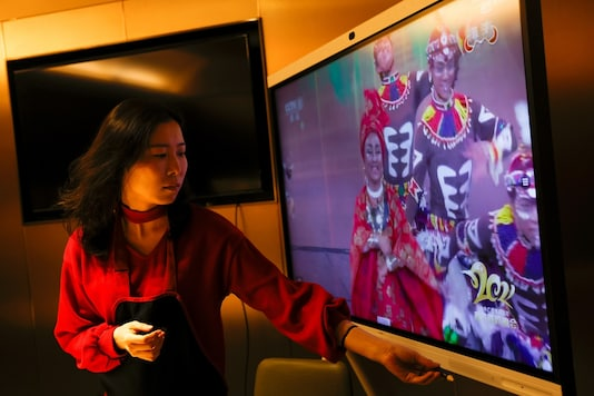 Liu Yuting  watches the Lunar New Year gala at a Haidilao hotpot restaurant, in Beijing.  REUTERS/Carlos Garcia Rawlins