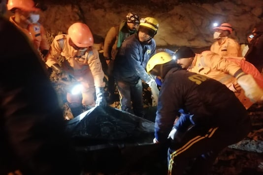 Uttarakhand police personnel, SDRF and NDRF jawans at work inside the Tapovan Tunnel. (Image: Twitter)