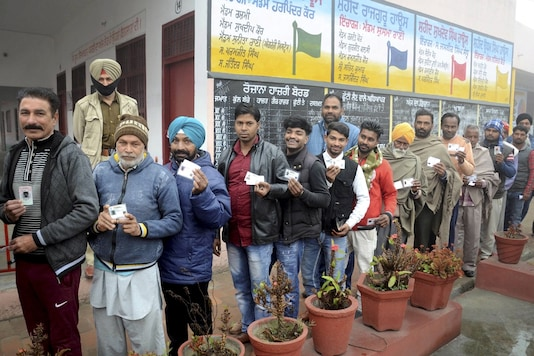 Amritsar: Residents stand in a queue to cast their votes during Punjab municipal elections, near Amritsar, Sunday, February 14, 2021. (Image: PTI)