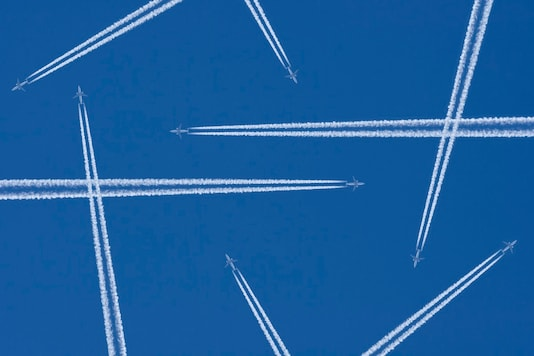 Airplanes in a Blue Sky with Vapor Trail, Air Traffic