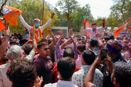 BJP workers celebrate the party's victory in civic polls in Ahmedabad. (PTI)