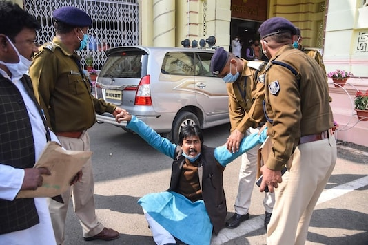 Patna: Police personnel detain CPI(ML) legislator Mahboob Alam during a protest in the Bihar Assembly amid the budget session, in Patna, Wednesday, Feb. 24, 2021. (PTI Photo)(