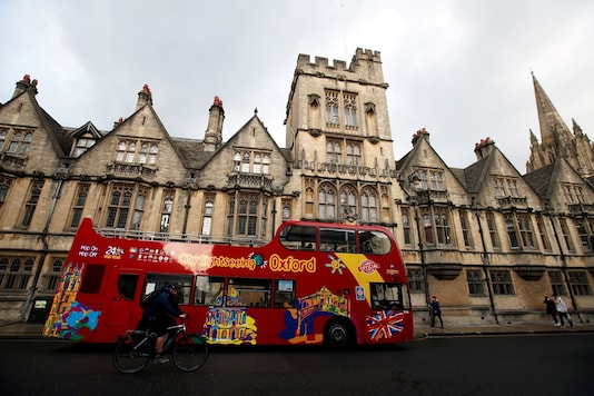 A sightseeing bus passes Oxford University building, amid the spread of the coronavirus disease in Oxford, Britain, October 6, 2020. (Reuters/File)
