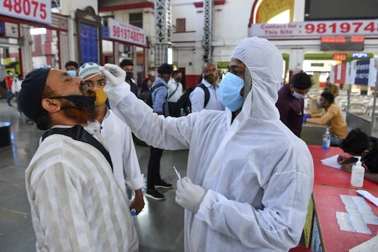 A health worker wearing protective gear takes a nasal swab.  (AFP)