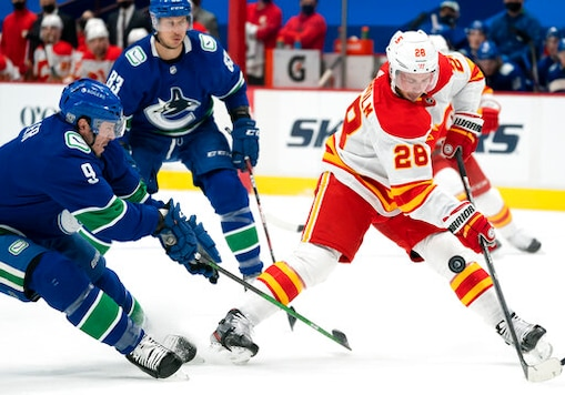 Flames Hand Canucks 6th Straight Loss In Series Opener