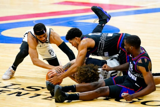 Embiid, Simmons Lead 76ers Past Short-handed Nets 124-108