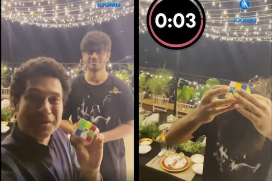 Video grab of Sachin Tendulkar with the young lad solving Rubik's cube. (Credit: IG)