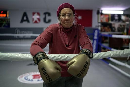 Nancy Van Der Stracten, 75-year-old suffering from Parkinson's disease, poses during a boxing practice break in the ring. (Credit: REUTERS)