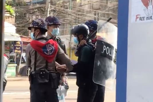 In this grab from a video taken on Feb 27, Associated Press journalist Thein Zaw can be seen being arrested by police in Yangon, Myanmar. (AP Photo)