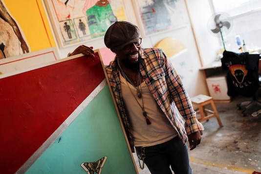 Artist Guy Stanley Philoche is pictured in his painting studio in the Harlem section of Manhattan in New York City. (Credit: REUTERS/Mike Segar)