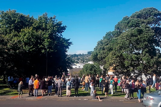 People gather on high ground in Whangarei, New Zealand, as a tsunami warning is issued on Friday. (AP)