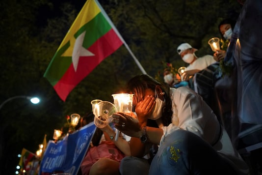 People gather to mourn those who died in Myanmar during anti-coup protests, in front of the U.N. building in Bangkok, Thailand March 4, 2021. REUTERS/Athit Perawongmetha