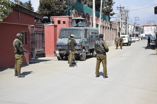 Security forces outside Mirwaiz Umar Farooq's residence on Friday. (Photo: News18)