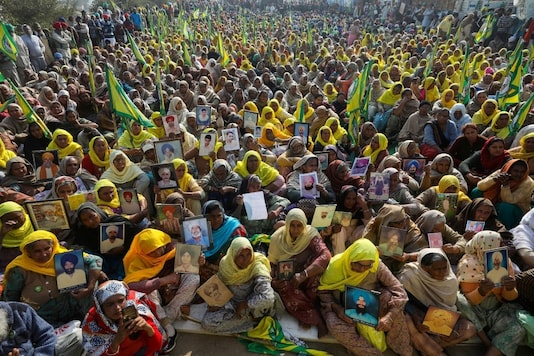 Women, including widows of farmers believed to have killed themselves over debt attend a protest against farm bills at Tikri border.