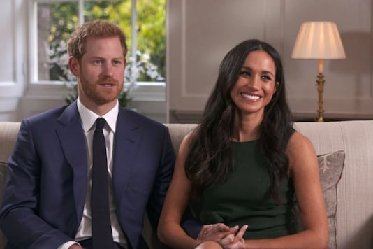 In this photo taken from video Britain's Prince Harry and Meghan Markle talk about their engagement during an interview in London, Monday, Nov. 27, 2017. It was announced Monday that Prince Harry, fifth in line for the British throne, will marry American actress Meghan Markle in the spring, confirming months of rumors. (Pool via AP)