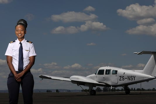 Refilwe Ledwaba, a pilot training young African women to become aircraft and drone pilots, poses for a photograph at the Grand Central airport in Midrand, South Africa February 28, 2021. REUTERS/Siphiwe Sibeko